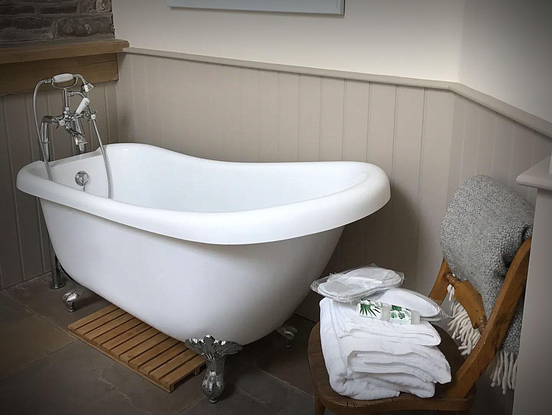 Luxury bath in the bedroom at Yarlington Dairy